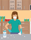 istock Woman Wearing An N95 Mask Cleaning Her Counter 1214266432