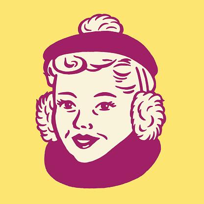 Woman Wearing Cap and Earmuffs