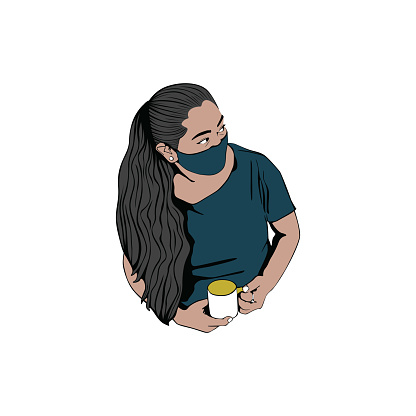 Woman wearing the protective face mask and drinking coffee.