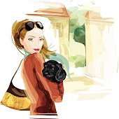 Illustration of a woman holding a black puppy. Woman, dog and background are grouped and layered separately.