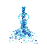 istock Woman with dress from snowflakes. 1184582169