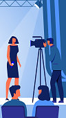 Woman with Microphone in Hand on Stage in front Videographer. Business Training for Women. Vector Illustration. Woman Holds Lecture. Woman Business Clothes in Conference Hall. Event Host.