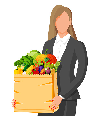 Woman with paper bag full of fresh vegetables.