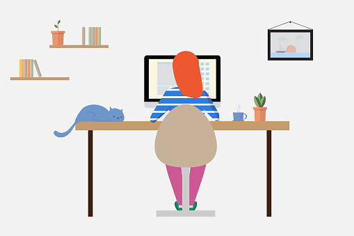 Woman working at home on a personal computer in the room
