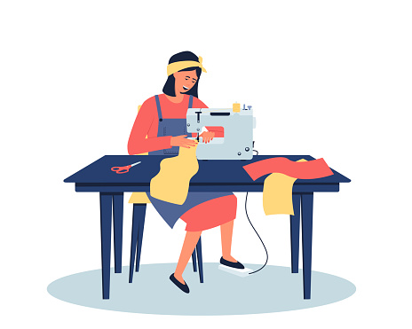 A woman works at home at her desk