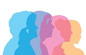 A vector silhouette illustration of the age progression of female from teenager to young adult to mature adult to senior.  The heads are transparent and in different colours.