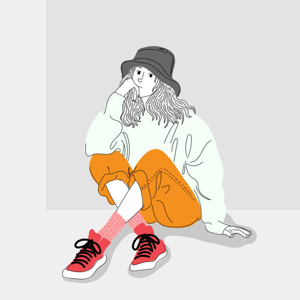 Women dressed in street fashion were sitting in one of the city walls.Illustration of a girl sitting on a wall. vector art illustration