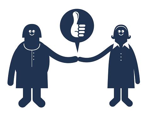 Women Helping Women, Team work, Two smiling women shaking hands
