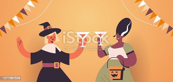 istock women in costumes celebrating happy halloween holiday mix race girls drinking cocktails having bar party 1277587529