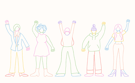 Women standing with their fists raised up in the air