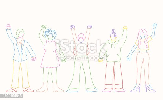 istock Women standing with their fists raised up in the air 1304495843