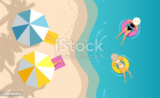 istock Women swimming on the inflatable ring 1096985852