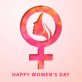 Celebrate the International Women's Day with paper craft of woman's head inside female gender symbol on the pink watercolor background