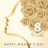Gold colored ribbon and roses forming a woman's head to celebrate the International Women's Day