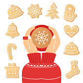 Women's hands holding a cup of coffee. Christmas card with a Cup of cocoa. The concept of a cozy new year café. Top view. Christmas ginger cookies. Homemade cookies for the new year. Seasonal clipart