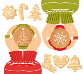 Women's hands holding a cup of coffee. Concept of friendship. Christmas card with a Cup of cocoa. The concept of a cozy new year café. Top view. Christmas ginger cookies. Homemade cookies for the new year. Seasonal clipart
