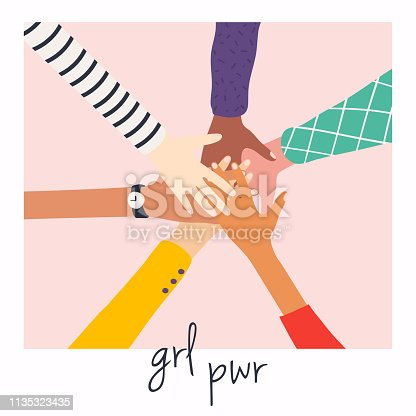 istock Women's hands on top of each other. Girl Power. Feminism symbol. 1135323435