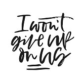 I won't give up on us hand written calligraphic phrase. Hand drawn vector illustration, greeting card, design, logo. Black and white brush pen writing.