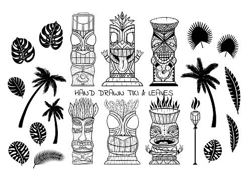 Wood Polynesian Tiki idols, gods statue carving, torch, palm trees, tropical leaves.