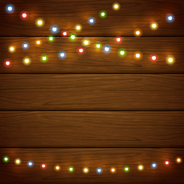 ilustrações de stock, clip art, desenhos animados e ícones de wooden background with colorful christmas lights - christmas table