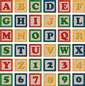 A set of brightly coloured wooden child's alphabet blocks. Includes all letters of the alphabet as well as a full set of numbers.