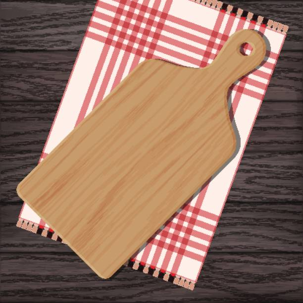 Wooden chopping board with gingham cloth Cutting board with gingham cloth on wooden background. Vector color illustration clipart cutting board stock illustrations