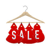 istock Wooden clothes hanger with discounts in the shape of Christmas trees. Realistic vector illustration 1197745254