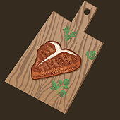 istock Wooden Cutting Board with Grilled T-Bone Steak 1331968010