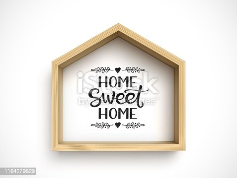 Wooden house frame on white background with hand lettering phrase Home Sweet Home