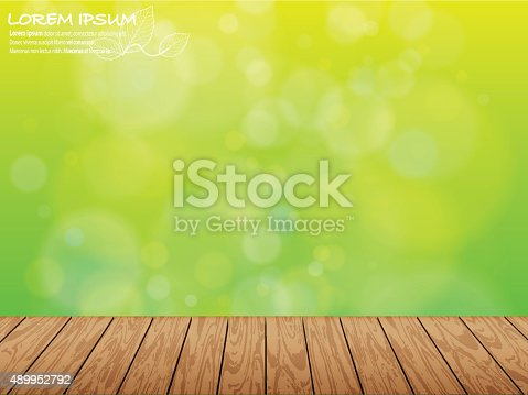 istock Wooden pieces and natural green blur 489952792