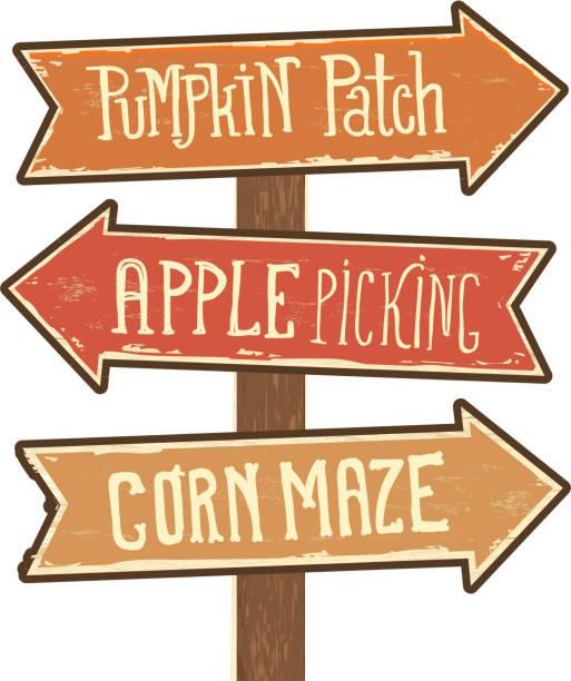 木標誌張貼箭頭指向南瓜補丁, 蘋果採摘和玉米迷宮 - 方向標誌 幅插畫檔、美工圖案、卡通及圖標