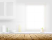 Wooden table on a kitchen background