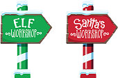 Set of two Vector illustration of a Wooden winter Christmas Santa Workshop and Elf Workshop sign with handwriting or hand lettered text. Easy to edit.