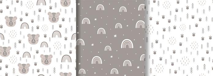 Woodland seamless pattern set Scandinavian animal paw, forest tree. Baby bear, rainbow Kids wildlife fabric design.