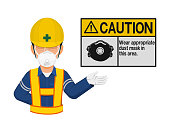 A worker with dust mask is presenting dust mask warming sign