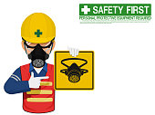 A worker with respiratory mask is presenting respiratory mask sign
