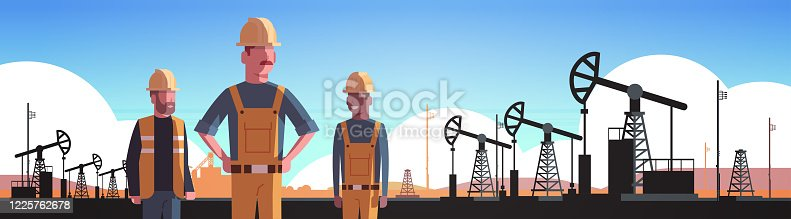 istock workers in orange uniform working on oil drilling rig pumpjack petroleum production trade oil industry concept portrait horizontal 1225762678