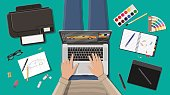 Workplace of freelance designer. Illustrator desktop with tools. Laptop pc, glasses, notes, pen, printer. Sketch on paper blank. Graphic tablet and color palette. Vector illustration in flat style
