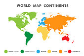 World map divided into six continents in different color. Colored map of the World with countries borders. Vector stock