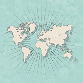 Map of World in a trendy vintage style. Beautiful retro illustration with old textured paper and light rays in the background (colors used: blue, green, beige and black for the outline). Vector Illustration (EPS10, well layered and grouped). Easy to edit, manipulate, resize or colorize.