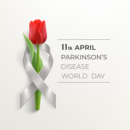 World Parkinson's disease day banner with ribbon and flower