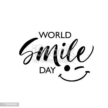 World smile day phrase. Modern vector brush calligraphy. Ink illustration. Vectorillustration of handwritten lettering.