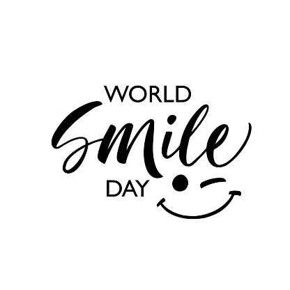 World smile day phrase. Modern vector brush calligraphy. Ink illustration.