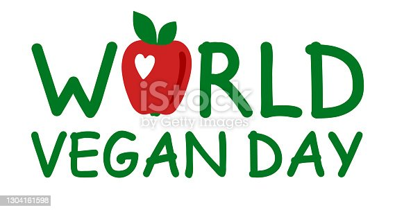 istock World vegan day. International november holiday. Hand drawn original lettering with an apple. Green letters isolated on a white background. Flat vector stock illustration for greeting card, poster. 1304161598