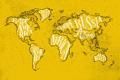 Vintage worldmap with inscription greenland, north america, south america, africa, europe, asia, australia, russia drawing on yellow paper background.