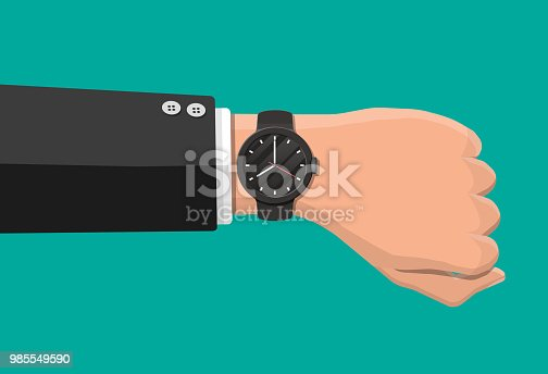 istock Wristwatch on hand. Man check the time. 985549590