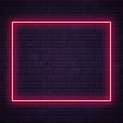 Wyoming map - Glowing neon sign on brick wall background