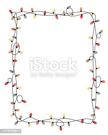 istock Xmas light bulbs frame, vertical rectangle shape. Simple but cute Christmas hand drawn frame. Vector illustration 1278783611