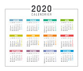 Colorful year 2020 calendar isolated, in French language, on white background. Vector template.