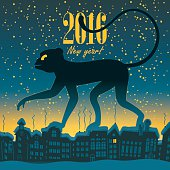 New Year card for 2016 with a monkey walking on the roofs of the city at night